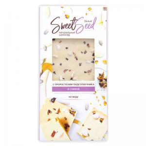 Шоколад белый на меду с проростками подсолнечника и сливой,